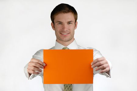 allegation: young businessman holds in hand  orange sheet of  paper on  white background