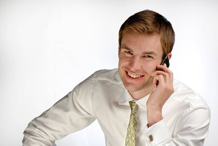 young businessman speaks by phone on  white background Stock Photo - 2025556