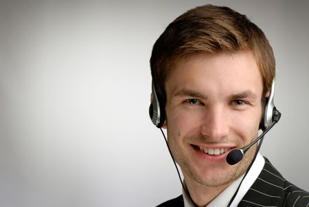 young businessman in headphones speaks on  microphone on  grey background Stock Photo - 2025558