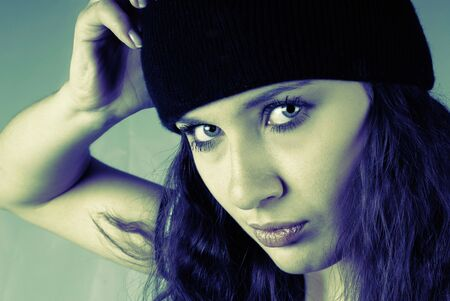 girl in sports  cap staring at the camera photo