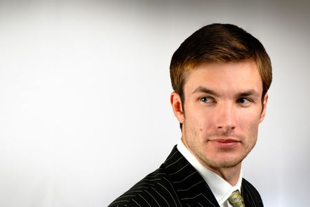 portrait of  young, cheerful, nice businessman on  gray background,  close up Stock Photo