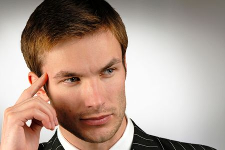 deep in thought: young businessman in deep thought Stock Photo