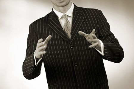 businessman emotionally gesticulates hands on  grey background photo