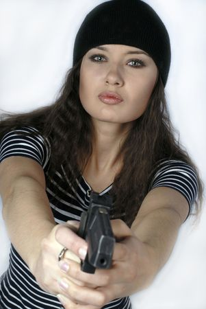 dare: young woman with  pistol in hands on  white background Stock Photo