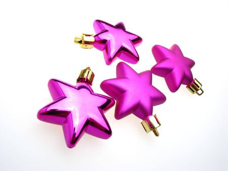 fur-tree toys an ornament of an asterisk of lilac color on  white background photo