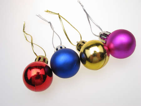decembe: four New Years spheres on  white background