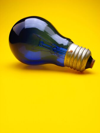 dark blue electric lamp on  yellow background photo
