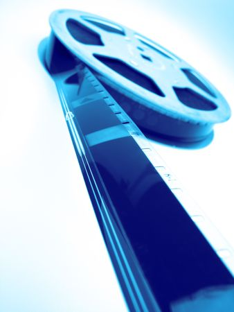 reel of  film of 16 mm on  blue background, close up photo