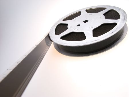 16mm: reel of  film of 16 mm on  white background, close up