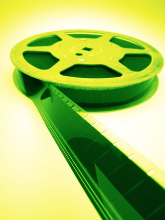 reel of  film of 16 mm on  green background, close up photo