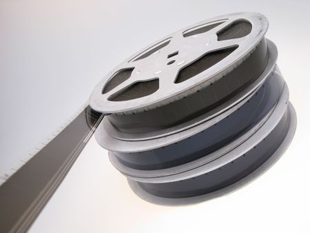 three reels  film  16 mm on  white background,  close up photo