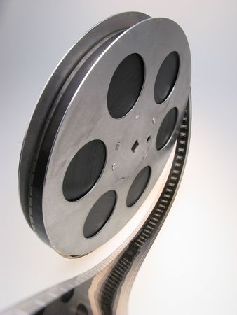 白い背景の上の 16 の mm のフィルムのリール、クローズ アップ