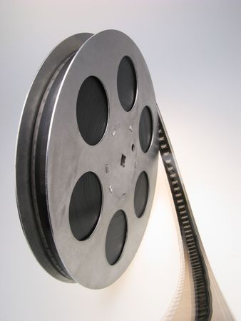 reel of  film of 16 mm on  white background, close up photo