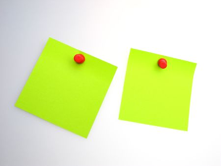 two sheet of  green paper and  red writing button on  light background photo