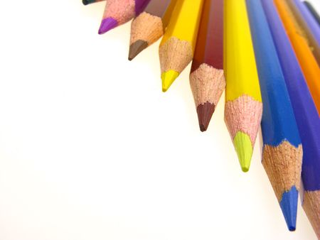 colorfully: dynamical composition from multi-coloured pencils on  light background, close-up