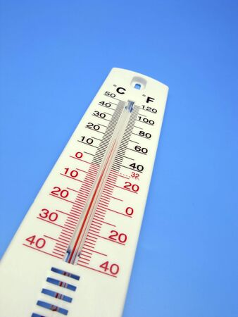 premise: thermometer for measurement of temperature in  premise on  blue background,  close up