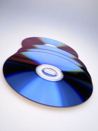 four dvd disks on  light background,  close up Reklamní fotografie - 2338699