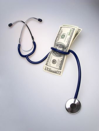 medical stethoscope and pack of dollar banknotes on light background