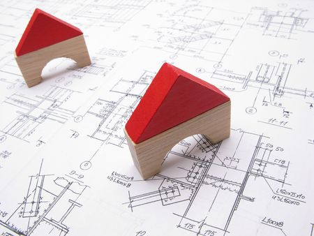 Toy houses and drawings, close up