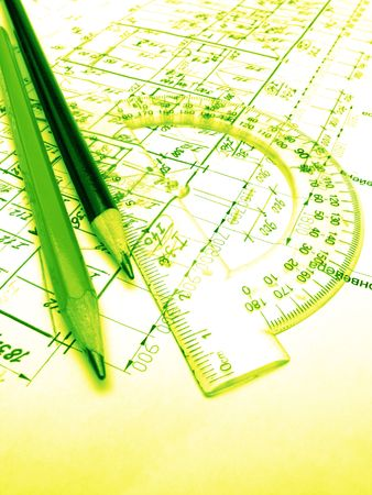 protractor: Pencils, protractor and drawings, close up