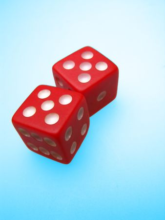 Two red dice on blue background, craps photo