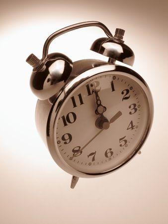 Alarm-clock on light background photo