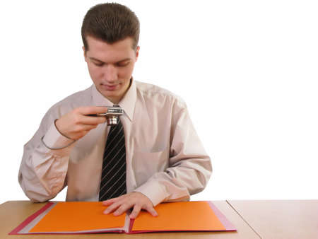 Young businessman photographing documents, isolated