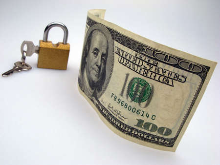 US dollar banknote, lock and key on light background photo