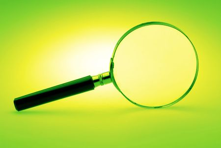 Manual magnifying lens on  green background,  close up Stock Photo