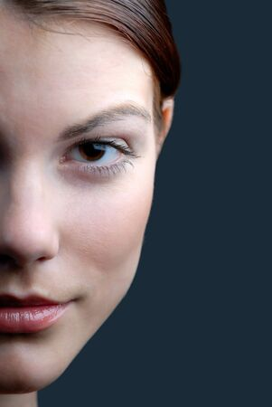 Portrait of  young girl on  dark background,  close up Stock Photo - 2704094