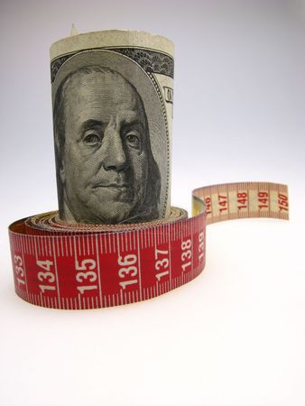 budget restrictions: Dollars are twisted by measuring meter,  close up Stock Photo
