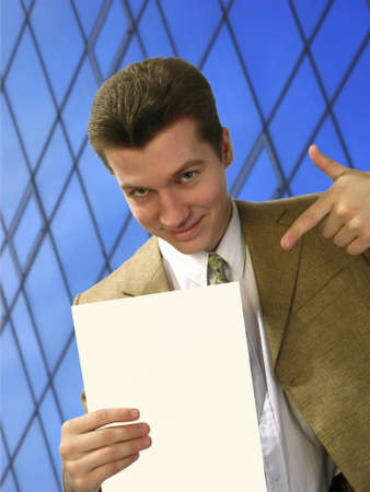 specifies: young businessman specifies  pure sheet of  paper Stock Photo