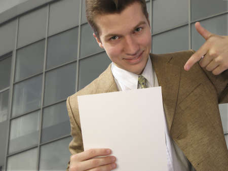 specifies: young businessman specifies  pure sheet of  pape Stock Photo