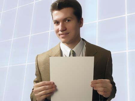 young businessman holds in hands �����  sheet of  paper Stock Photo - 2943206