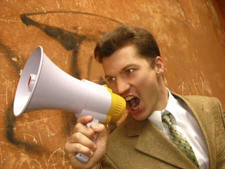 young businessman shouts in  megaphone Stock Photo - 3020852