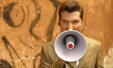 young businessman shouts in  megaphone Stock Photo - 3020851