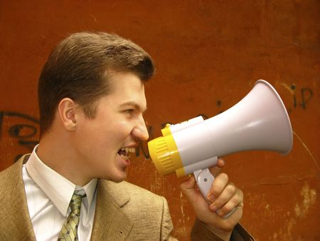 young businessman shouts in  megaphone photo