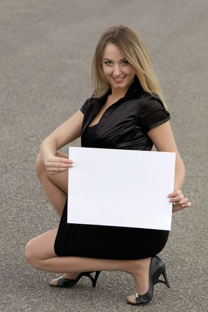young business woman holding an empty white card Stock Photo - 3020838