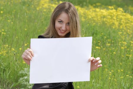 young business woman holding an empty white card photo