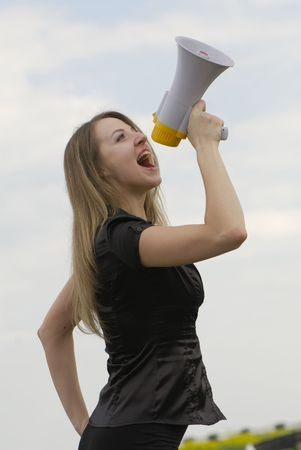 young businesswoman shouts in  megaphone Stock Photo - 3104639