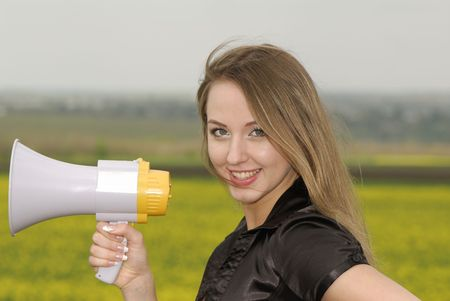 young businesswoman shouts in  megaphone Stock Photo - 3104643