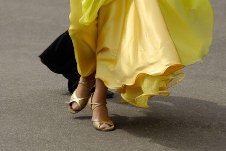 Legs of  dancing pair, shadow on asphalt photo