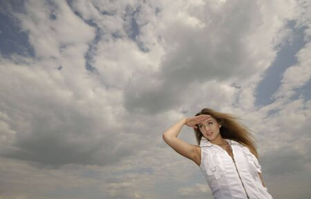 portrait of  young woman in white clothes on  background of clouds Stock Photo - 3144736