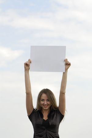 young business woman holding an empty white card Stock Photo - 3171510
