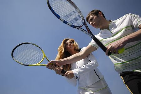 man  instructor on tennis trains  woman in skills of game Stock Photo - 3317123
