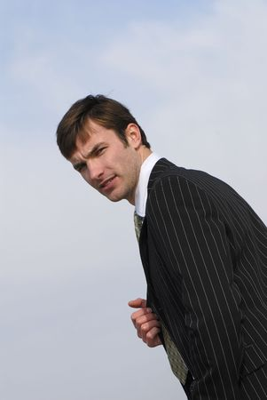 executive affable: Portrait of  young successful businessman on  background of  sky Stock Photo