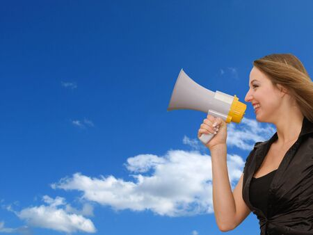 woman speaks in magaphone on background of blue sky Stock Photo - 3813711