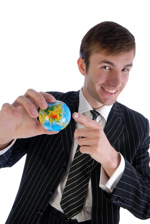 specifies: young smiling businessman specifies model of globe isolated on  white background Stock Photo