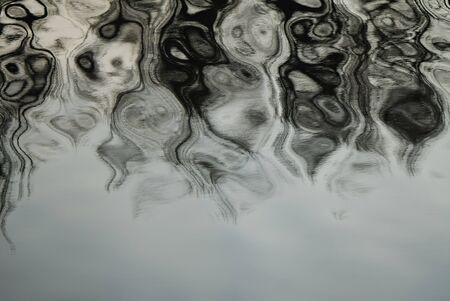 Composition from rhythmical waves on a surface of water of contrast grey color  photo