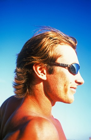 Portrait young men in  structure in  sun goggles on  background of  dark blue sky Stock Photo - 4383686
